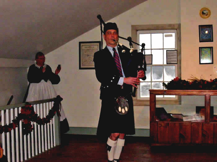 Robert McWilliams plays bagpipes in the Ballroom.